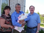 Lena and Alex, Who Have Hosted Me So Many  Times. He Is Holding A New Grand Baby.  Kazilovka, Ukraine, May, 2010.